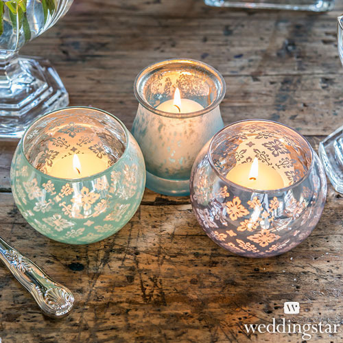 http://www.weddingfavoursaustralia.com.au/products/large-glass-globe-votive-candle-holders-with-reflective-lace-pattern-set-of-4