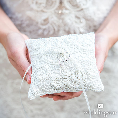 http://www.weddingfavoursaustralia.com.au/products/white-beaded-miniature-wedding-ring-pillow