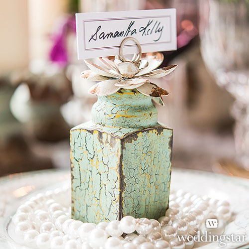 http://www.weddingfavoursaustralia.com.au/products/set-of-4-vintage-inspired-place-card-holders-slash-table-number-holders-with-floral-detail-set-of-4