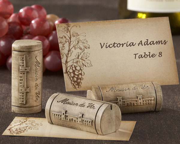 http://www.weddingfavoursaustralia.com.au/products/set-of-4-maison-du-vin-wine-cork-place-card-slash-photo-holder-with-grape-themed-place-cards