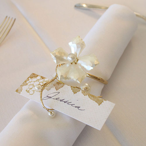 http://www.weddingfavoursaustralia.com.au/products/pearl-and-vintage-gold-wire-ornamental-floral-mini-napkin-rings-set-of-8