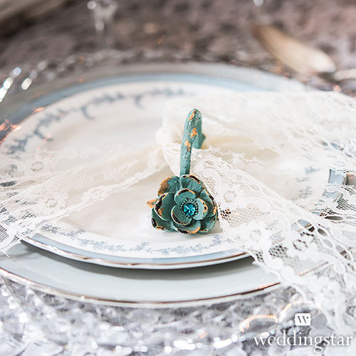 http://www.weddingfavoursaustralia.com.au/products/vintage-floral-napkin-ring-with-distressed-finish-and-jewel-accents-set-of-2