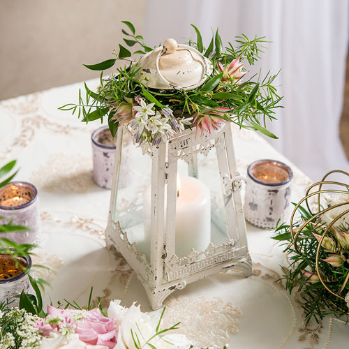 http://www.weddingfavoursaustralia.com.au/products/metal-and-glass-pyramid-lantern