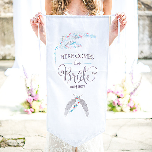 http://www.weddingfavoursaustralia.com.au/products/feather-whimsy-personalised-ceremony-banner