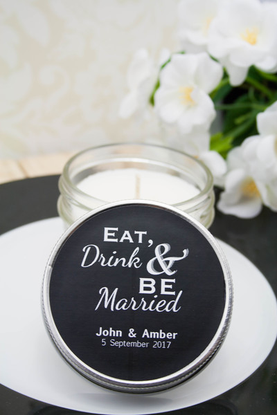 http://www.weddingfavoursaustralia.com.au/products/personalised-wedding-candles-in-a-4-oz-vintage-modern-jar-eat-drink-and-be-married